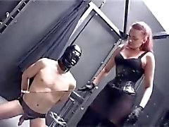 Dominatrix the subs place.with Strapon