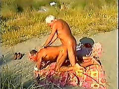 Темный цвет пляжа пап Минет без , со зрителем