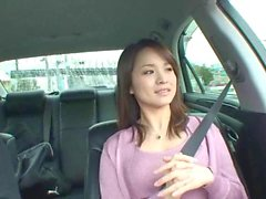Sweet asian babe in the car