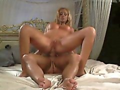 Buxom blonde rubs her aching clit while a hung stud punishes her ass