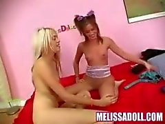 Hot petite Melissa Doll in a strapon session with Kelly Summer