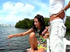 Tiny girl on a boat sucks big dick
