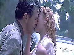 Drew Barrymore making out with a guy on the hood of a car