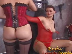 Girl in red fishnet lingerie dominated and