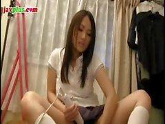 Young Asian schoolgirl eats his cock in the bathroom and vibs her twat