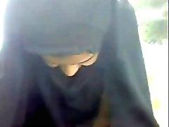 Hijabi girl changing panty in park