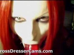 Nasty crossdresser cums on her own face