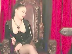 Smoking latex femdom gets heels licked clean