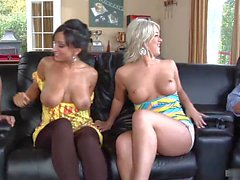 Bisexual MILFs Cayden Moore and Rikki White are seen here kissing, before taking