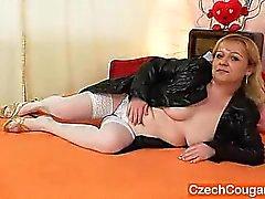 Orgasmic elder cougar wears stockings and toys herself