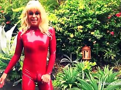 Latex dressed Mature Shemale Cums in the Garden