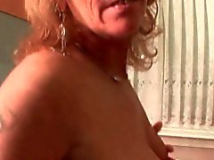 Mature hoe masturbating pussy in kitchen