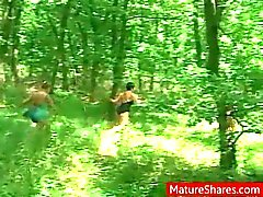 Horny granny prowls the forest for blowjobs