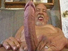 Oude man met een grote gereedschap wanking
