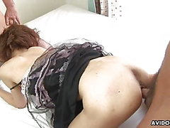 Mesmerizing Asian slut rides a cock and sucks the other one