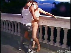 Busty shemale fucks fondly guy on balcony