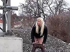 Blonde taking a walk needs to piss in snow