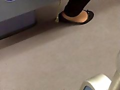 Flats with pantyhose shoeplay in the train