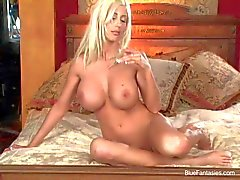 Blonde Puma Swede with huge fake balloons pleasures herself