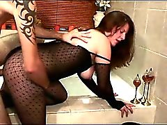 Slut in pantyhose blows and fucks two dicks in Amsterdam