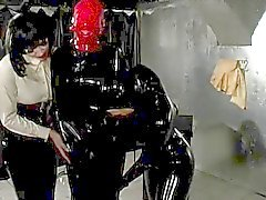 Mistress Latex Treats Her Gimp Suit Clad Slave To Breathplay