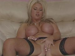 British slut plays with herself in fishnets