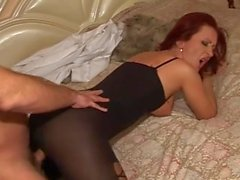 Slutty redhaid MILF in body stocking visits the doctor