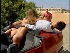 Busty blonde Lydia Pirelli threesome in a car M22