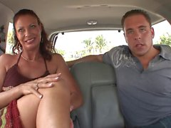 Horny MILF rides guy's tool in the back seat like a pro