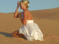 Bendy busty teen babe shows off natural assets on sand dunes