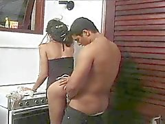 A Hot Shemale fucks in the kitchen