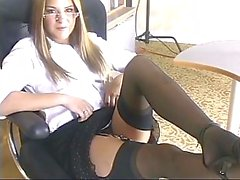 Tiny titted teen in glasses strips and plays with a dildo at her desk