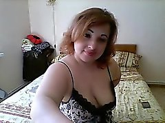 Chubby mature redhead wears her lingerie while she poses on