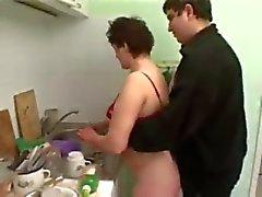 maldito pareja rechoncho en la cocina
