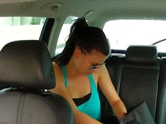 girl changes her clothes in the back of a taxi