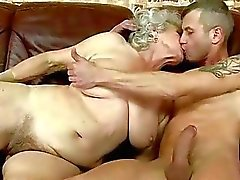 Hot busty granny gets fucked on the couch