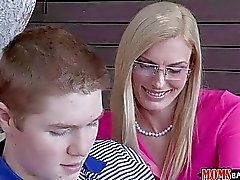 MILF stepmom shows boy how to lick pussy