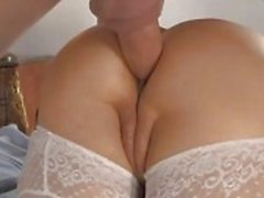 Redhead mom rides a cock deep in her ass