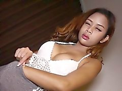 Thai ladyboy toying ass with buttplug