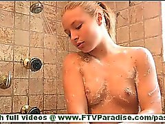 Ashley beautiful blonde with long hair and small tits taking shower stroking tits and toying pussy