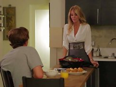 Beautiful MILF Jessica Drake gives blow job in the kitchen
